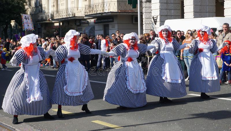 Five woman masked in the costume of baby dolls, dancing in the street in the carnival royalty free stock photos