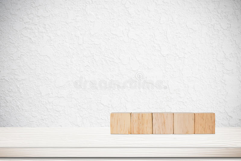 Five wooden cubes on table over cement wall background stock photos