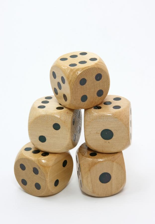 Five wooden gambling dices