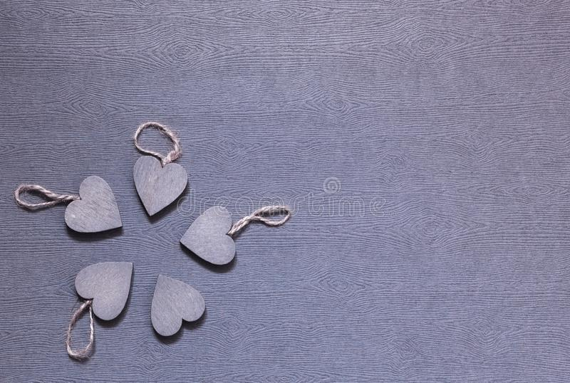 Five wooden grey hearts together stock photo
