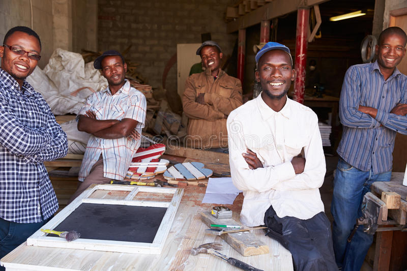 Five workers in a carpentry workshop, portrait, South Africa stock photos