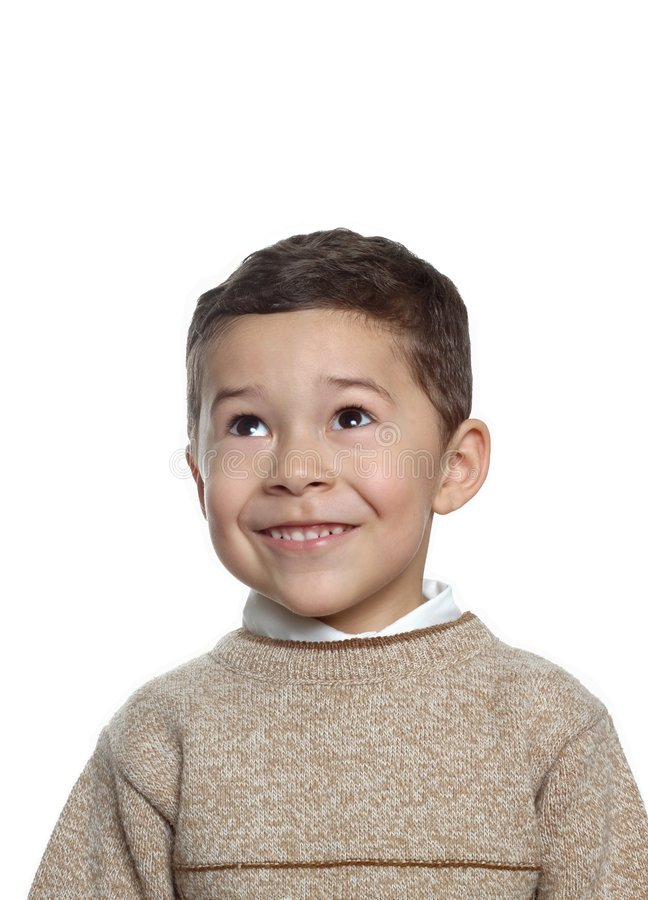 Five-year-old boy portrait. Vertical portrait of a handsome 5 year old hispanic boy wearing a tan pullover sweater, isolated on white background royalty free stock photography