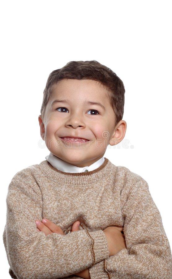 Five year old boy portrait. Vertical portrait of a handsome 5 year old hispanic boy with arms folded wearing a tan pullover sweater, isolated on white background stock photography