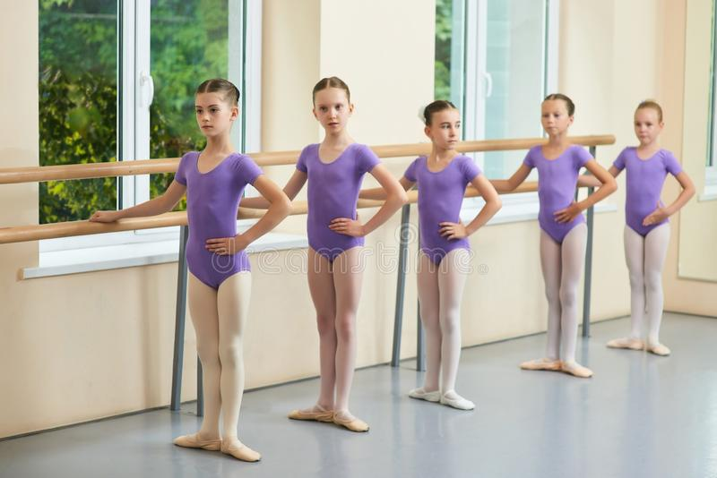 Five young ballerinas standing in pose. royalty free stock image