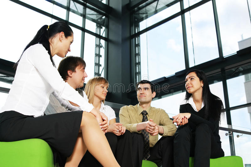 Five young business persons are having a meeting stock photo