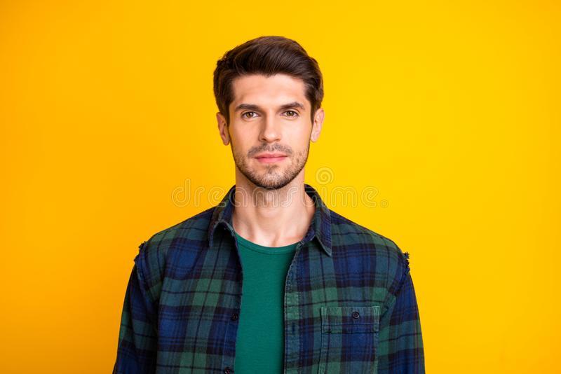 Fix temples please. Photo of amazing serious macho looking mirror in stylist salon wear casual outfit isolated yellow. Fix temples please. Photo of amazing stock photography