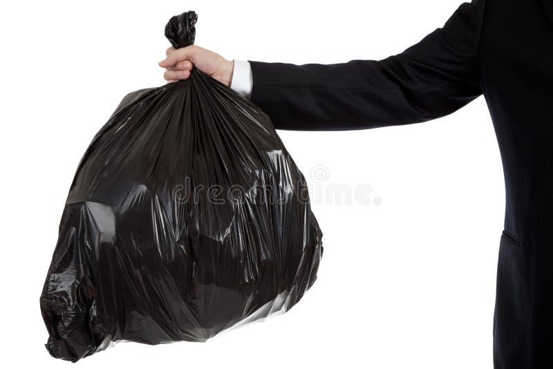 Fixation de bras d'homme d'affaires un sac de détritus photo stock
