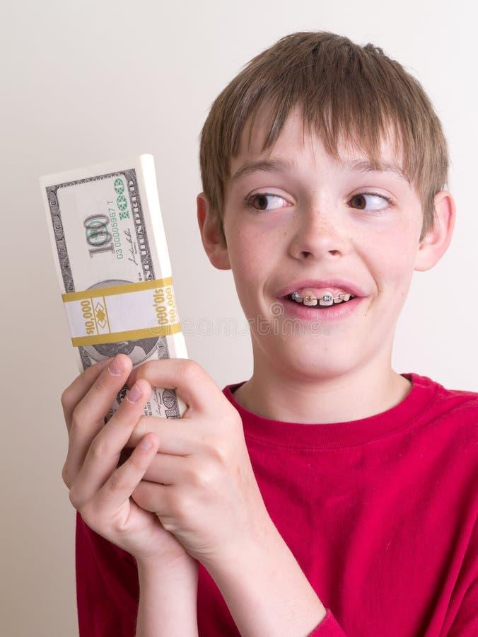 Fixation de l'adolescence beaucoup d'argent photos stock