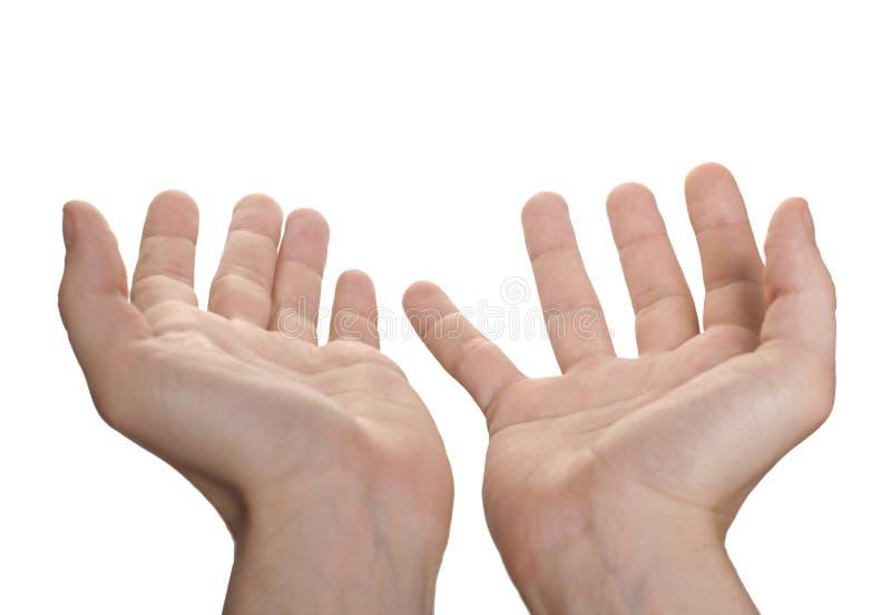 Fixation de la main des hommes formés par bien quelque chose photo libre de droits