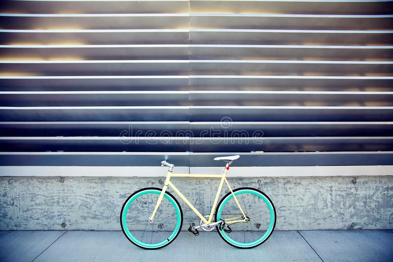 Fixed gear bike. Yellow, blue royalty free stock photo