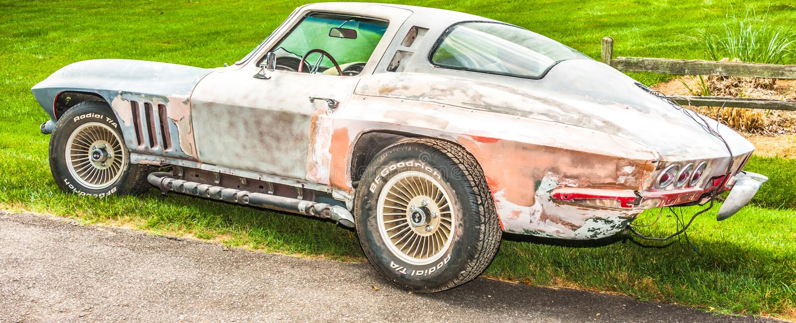 Fixer upper. Corvette needing a lot of body work. That will turn into a master head turner stock images