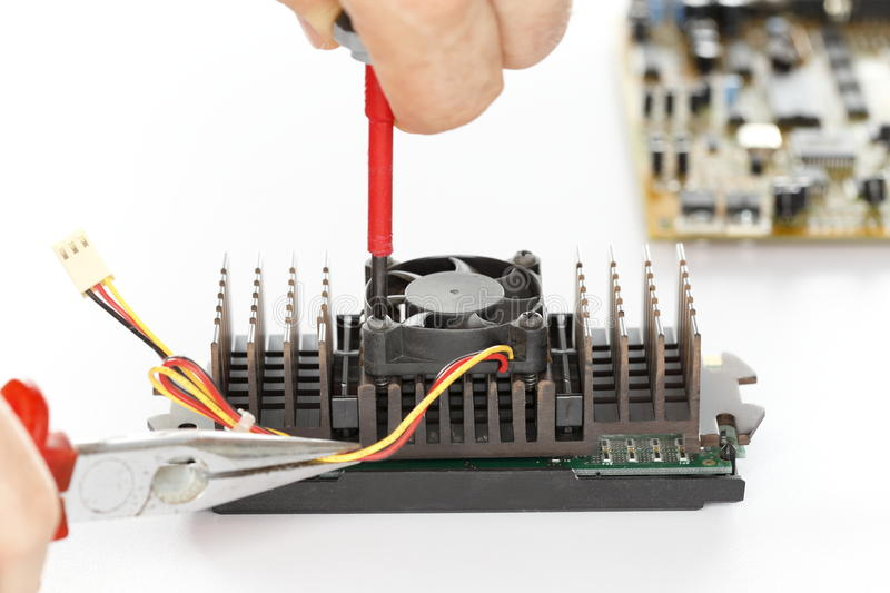 Fixing a component. Man is fixing an electrical component with tools stock image