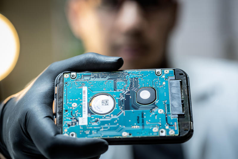 Fixing computer hardware. Maintenance technician repairing computer hardware royalty free stock photography