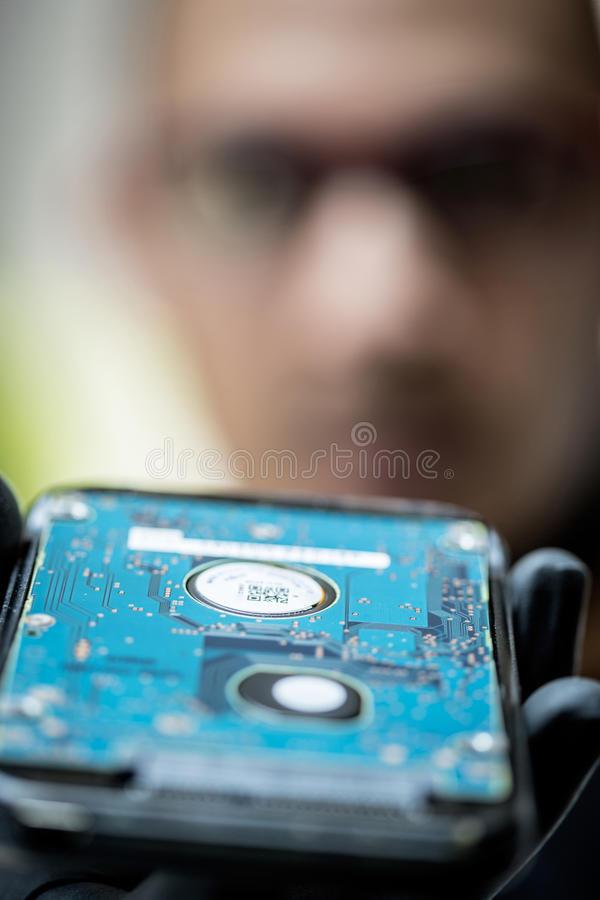 Fixing computer hardware. Technician fixing computer hardware and maintenance royalty free stock image