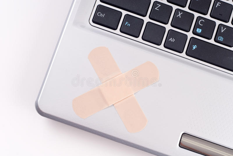 Fixing Computer Problems. Computer With Bandages For Repair stock image