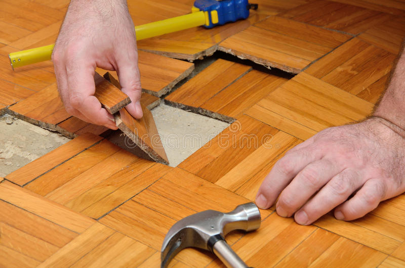 Fixing Damaged Parquet stock image