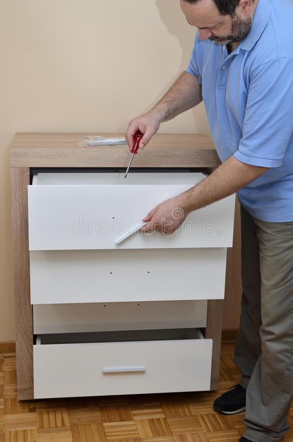 Fixing a Drawer Handle stock image