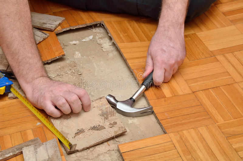 Fixing Parquet With Tools royalty free stock image