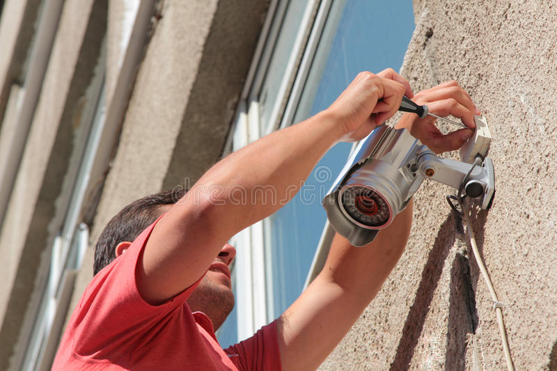 Fixing the security camera stock images