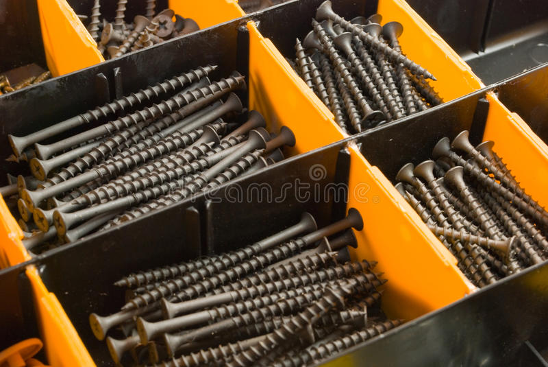 Fixture in a box. Bolts and screws stock images