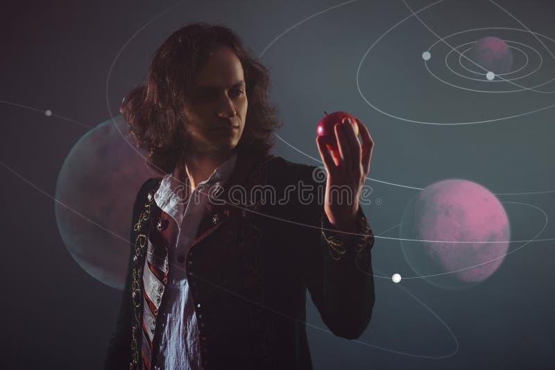 Fizyka nauka natura poj?cie studiowa? prawa natura M?ody cz?owiek w wizerunku Isaac newton zdjęcie royalty free