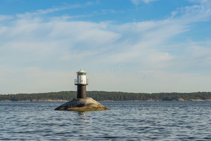 Fjärdhällan lighthouse Stockholm archipelago. Fjärdhällan lighthouse English: Bayskerry a fairway lighthouse at Jungfrufjärden bay in Stockholm stock photos