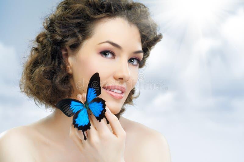 fjärilskvinna royaltyfri foto