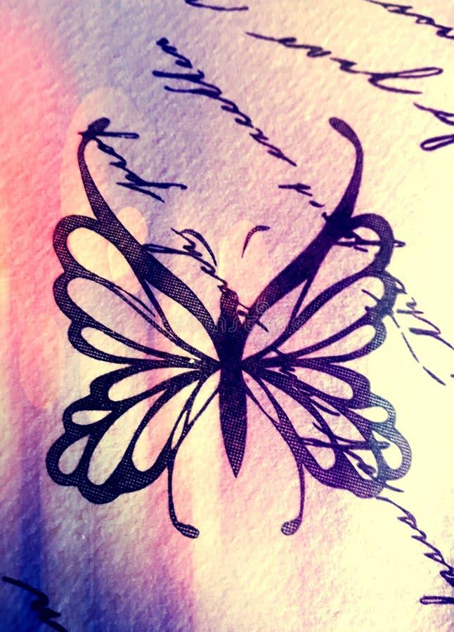 Fjärilssymbol på en tabell arkivfoto
