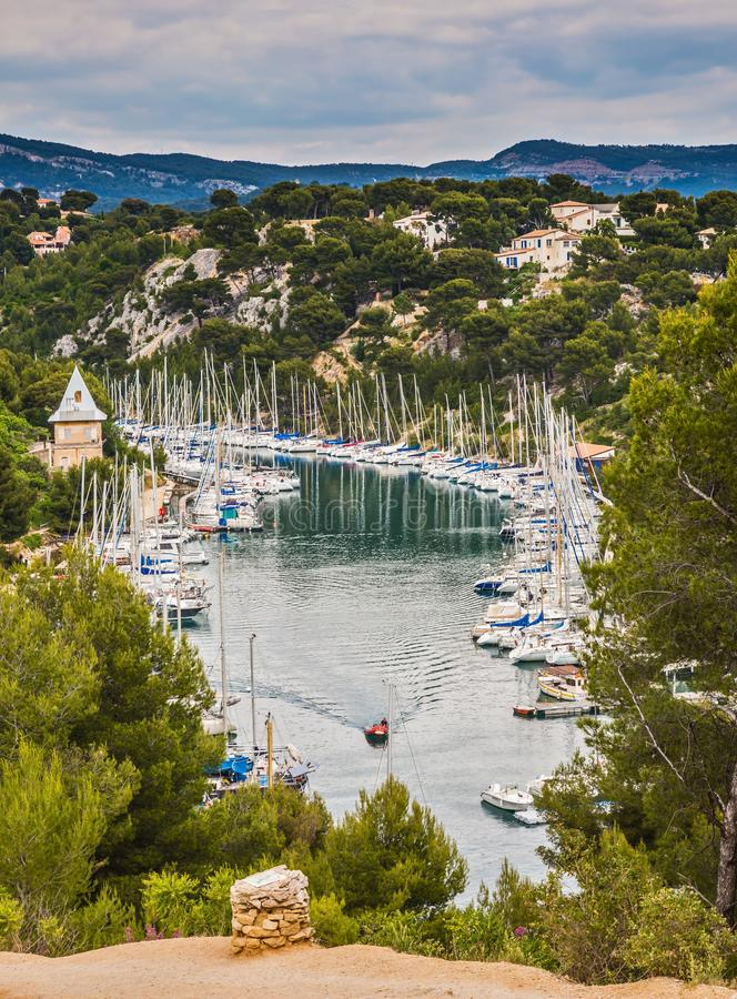 The fjord in Calanque National Park between Cassis and Marseille. White and graceful sailing yachts in turquoise water of the royalty free stock photos