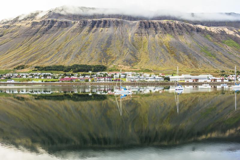 Fjord reflection on the water at Isafjordur, Iceland royalty free stock image