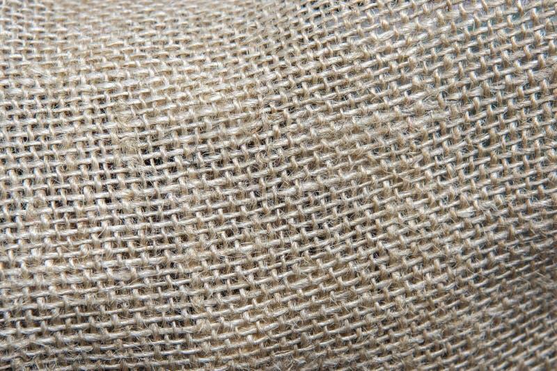 Flätad samman textur av den grova tråden sackcloth fotografering för bildbyråer