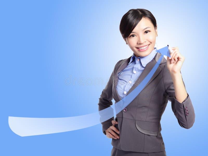 Flèche d'attraction de femme d'affaires de réussite image libre de droits