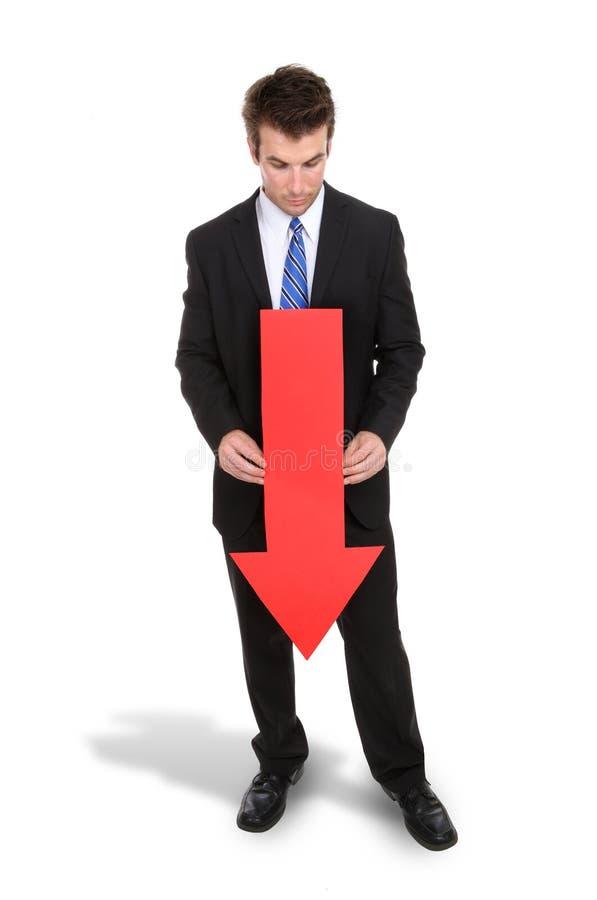 Flèche d'homme d'affaires vers le bas photo libre de droits