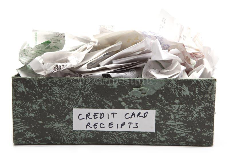 flödande över kvitton för kortkreditering royaltyfri foto