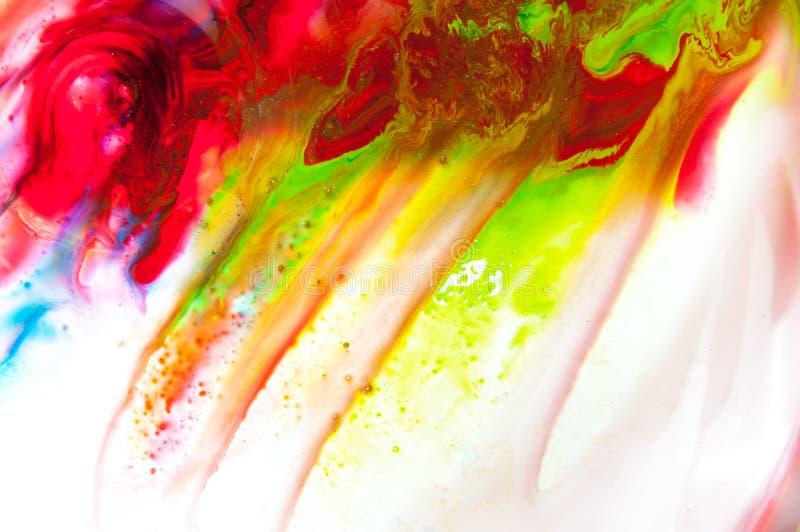 Flödande målarfärg arkivfoton