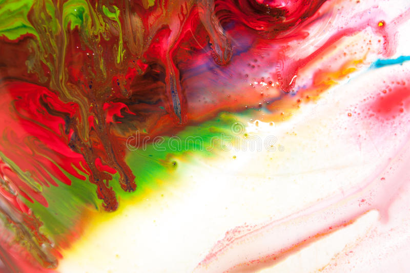 Flödande målarfärg arkivbild