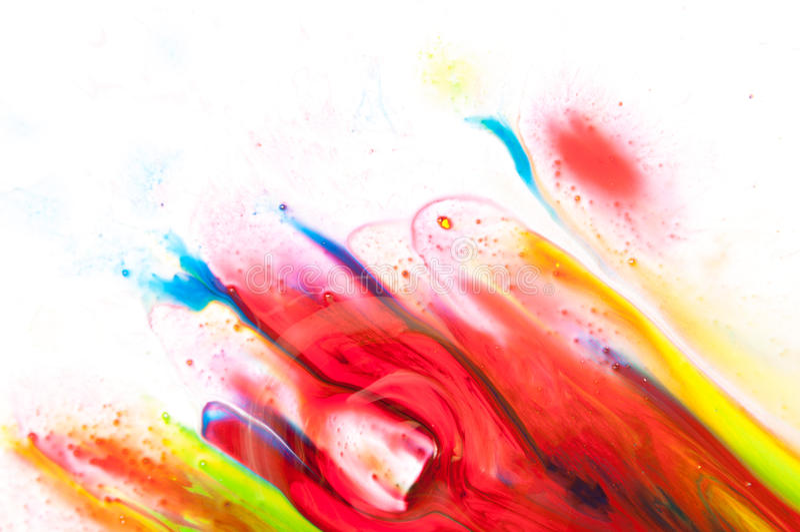Flödande målarfärg arkivfoto