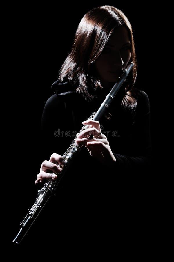 Flöjtist som spelar flöjten arkivbilder