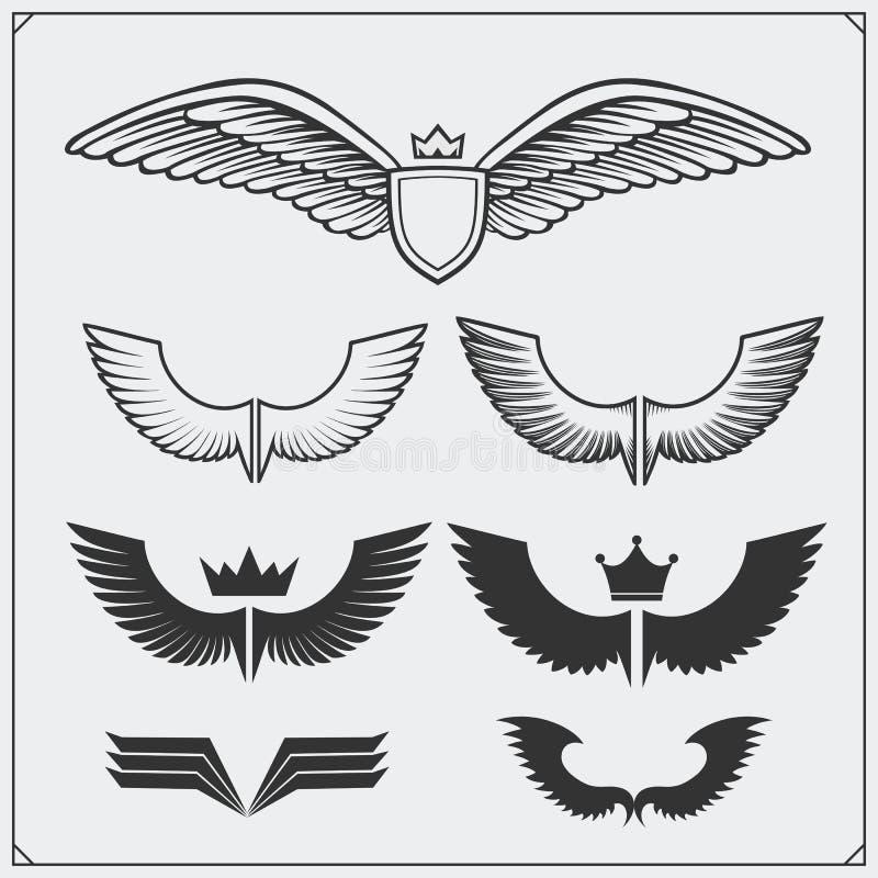Flügel stellten ein Vier Schneeflocken auf weißem Hintergrund Auch im corel abgehobenen Betrag vektor abbildung
