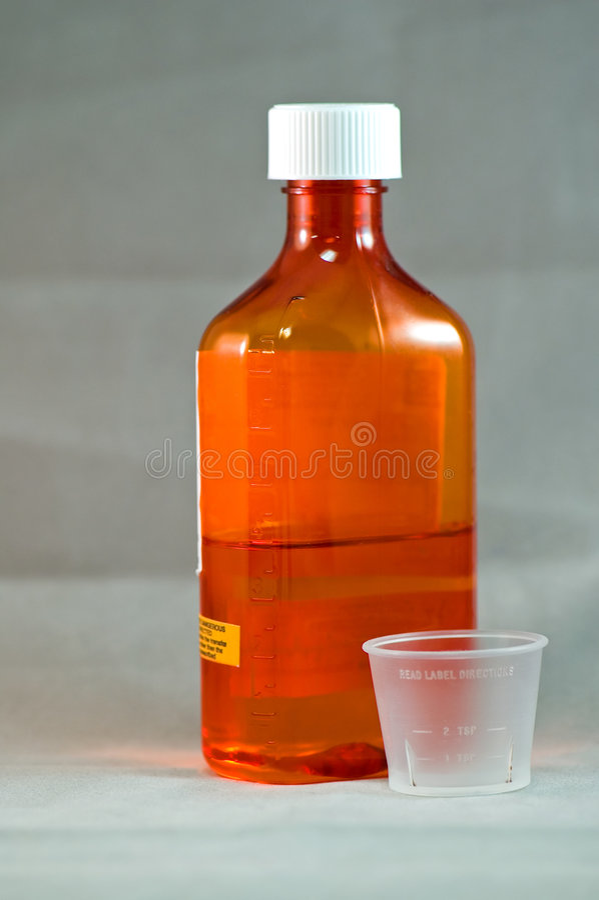 Flüssiger Hustensirup stockfoto