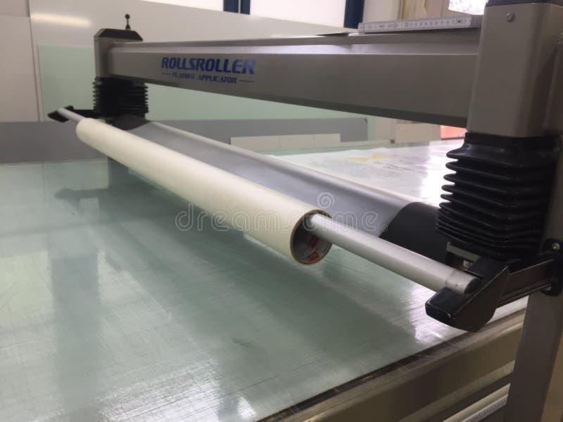 Flachbettapplikator Rollsroller für die Zeichenherstellung stockfotografie