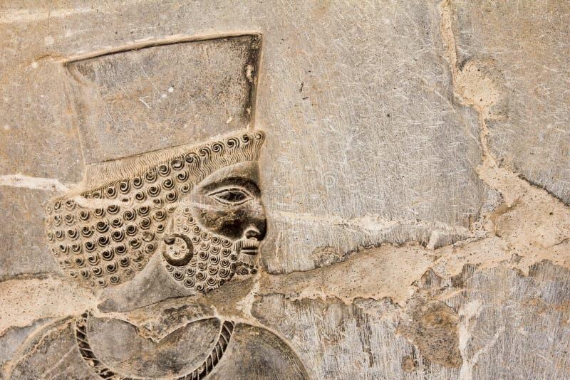 Flachrelief des persischen Soldaten stockbilder