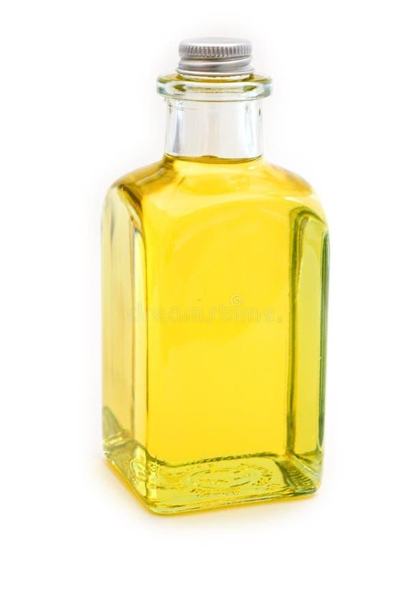 Flacon de pétrole jaune images stock