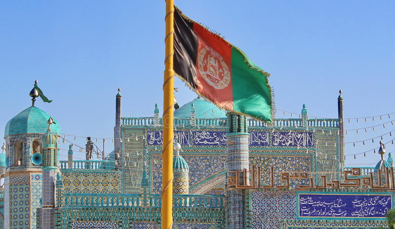 Flag of Afghanistan. Near the mosque in Mazar-e Sharif royalty free stock photos