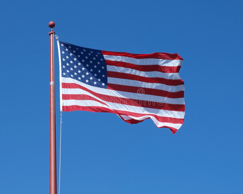 Download Flag Against A Clear Blue Sky Stock Image - Image: 14443309