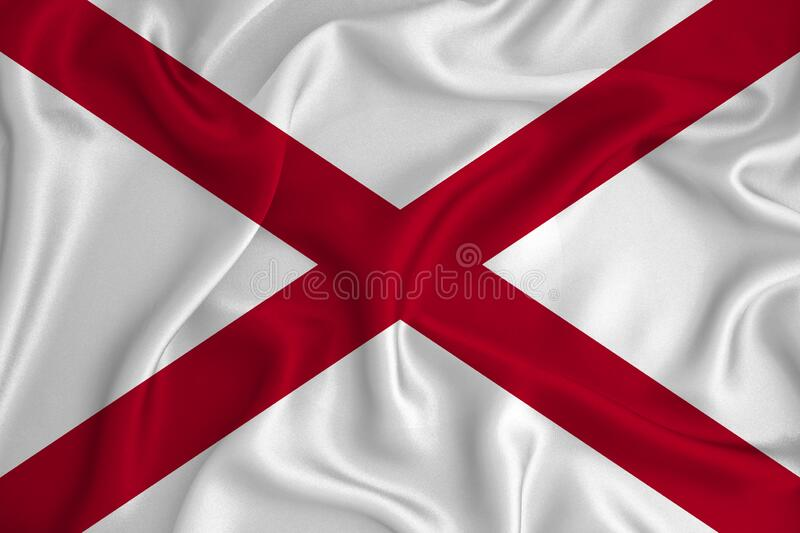 Flag of Alabama in the United States on the background texture. Concept for designer solutions.  royalty free stock photos