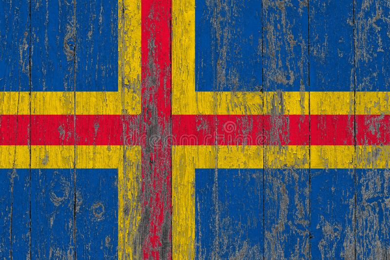 Flag of Aland Islands painted on worn out wooden texture background.  stock images