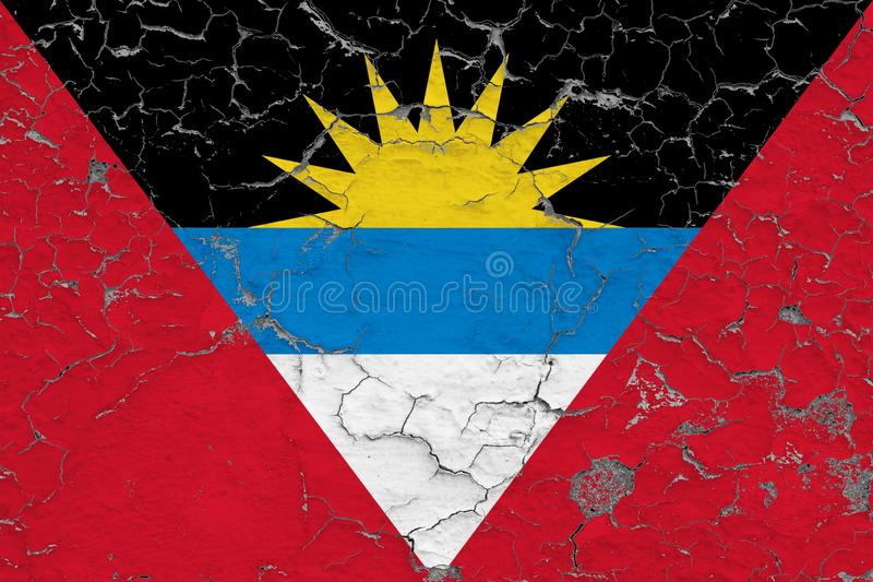 Flag of Antigua and Barbuda painted on cracked dirty wall. National pattern on vintage style surface stock photo