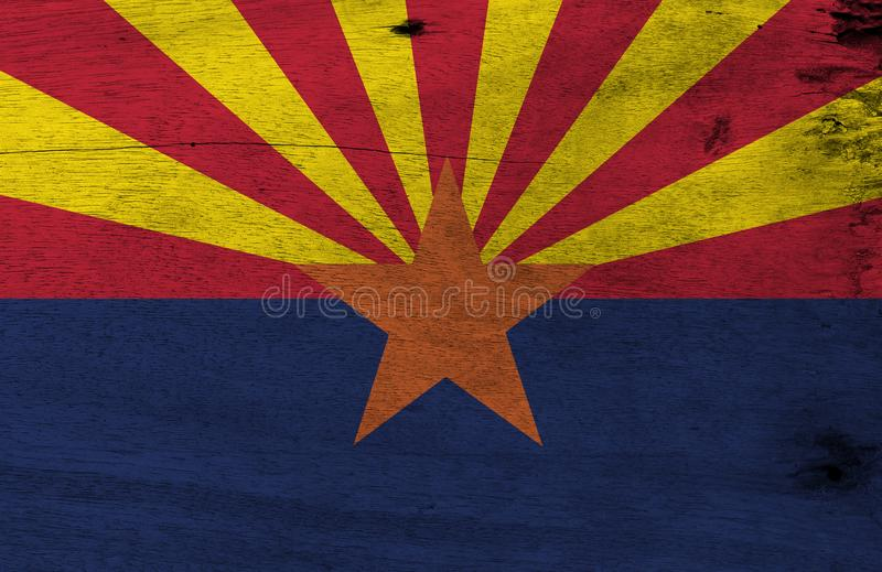 Flag of Arizona on wooden plate background. Grunge Arizona flag texture, The states of America. stock photos