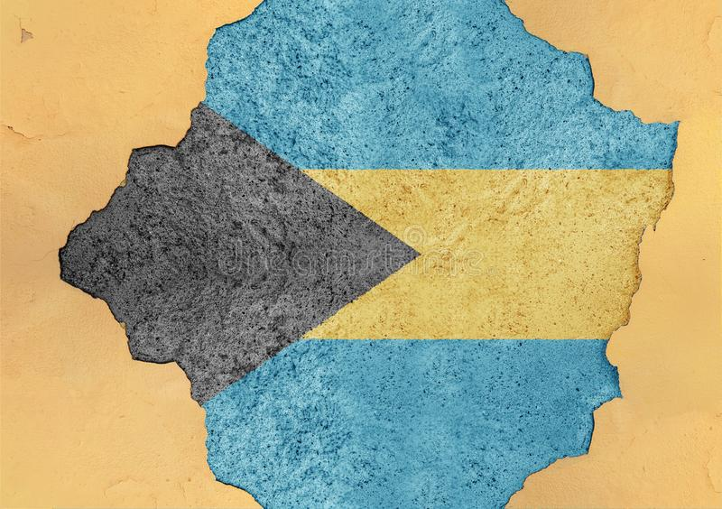 Flag of Bahamas in big broken material concrete cracked hole facade. Structure stock images
